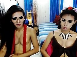 Two charming camgirls displaying the sublime contours of th