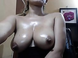 Sultry girl with a perfect booty greases up her magnificent