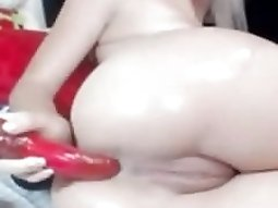 Oiling her ass then toying her asshole