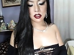 Dark-haired sex goddess knows how to seduce with her pouty