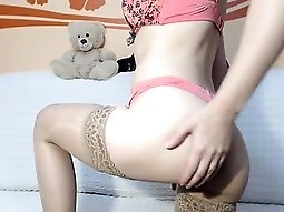 Provoking blonde in stockings exposes her marvelous ass and
