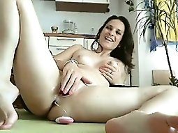Provoking redhead babe uses fingers and sex toys to reach h