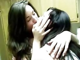 Lesbians Kissing In The Kitchen