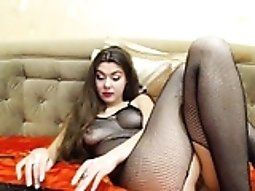 Big breasted chick in a fishnet bodysuit exposes herself on