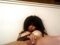 Moaning emo girl plays with her tits and pussy on her bed