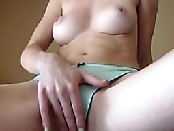 Busty babe with pouting nipples strokes her hairless pussy