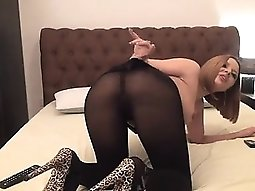 Busty slut in pantyhose rubs her vagina about the cam