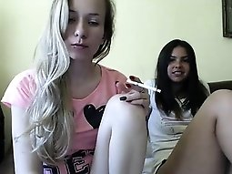 Blonde and brunette cuties flashing their sweet bodies on t