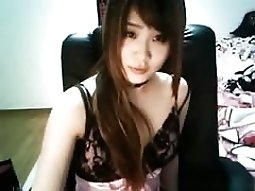 Cute asian girl sticks a needle in her nipple on cam