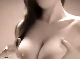 sexy brunette bombshell kneads her big natural tits in front of a webcam