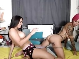 Lesbians have strapon fun on cam  More at cams.bestpornaround.com