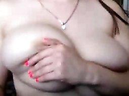 Hug tit brunette plays with her big tits on webcam