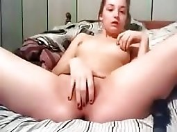 Cute girl with small tits plays with her deep penetration pussy on her bed