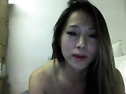 Cute brunette Japanese girl is on her live cam chatting and