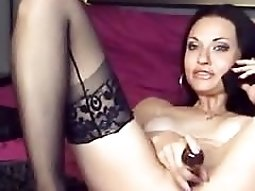 Sultry chick in black ass stockings masturbates while talking on the phone