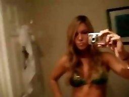 Hot dark hair chick teeny Strips Off Her Bikini And Teases In The Bathroom Mirror