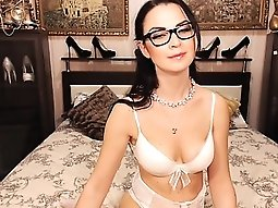 Nerdy brunette camgirl in sexy white lingerie reveals her a