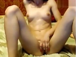 Cam model of Russian GracefulKaty masturbating on the bed