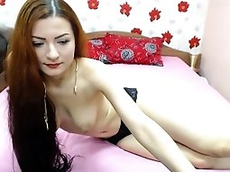 Mesmerizing redhead camgirl spreads her sexy slim body acro